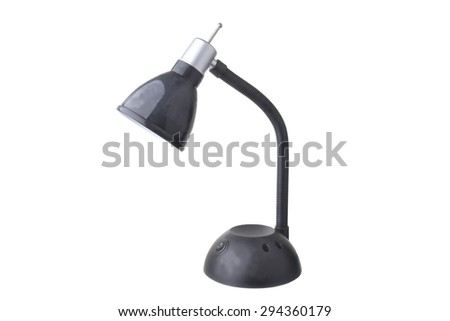 Close up shot of a black and silver desk lamp on white