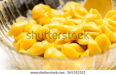 Close up shot of a bowl of macaroni shells and cheese