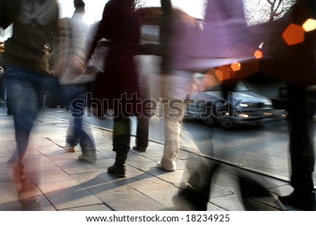 close up shot of a busy people walking - stock photo