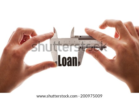 """Close up shot of a caliper, measuring the word """"Loan"""". - stock photo"""