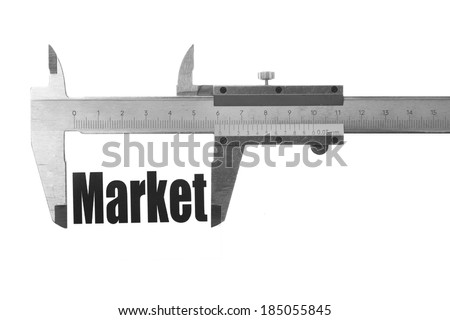 "Close up shot of a caliper measuring the word ""Market"". - stock photo"