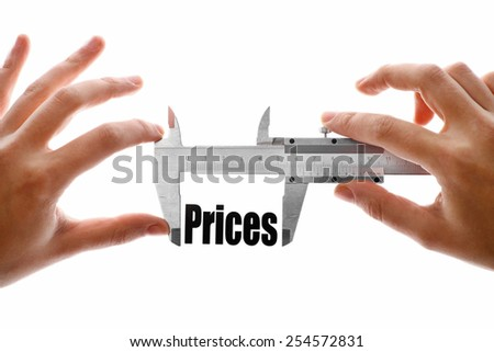 "Close up shot of a caliper measuring the word ""Prices"" - stock photo"