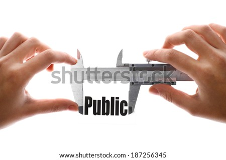 "Close up shot of a caliper measuring the word ""Public"". - stock photo"