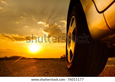 Close up shot of a car against sunset in the background - stock photo