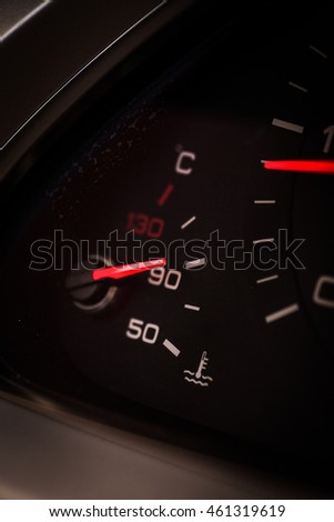Close up shot of a car's dashboard, with coolant gauge detail.