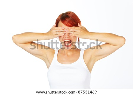 close-up shot of a caucasian beautiful woman. Hands over the face - stock photo