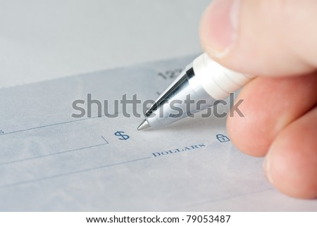 Close up shot of a cheque with a pen - stock photo