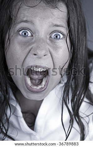 Close Up Shot of a Child Screaming - stock photo