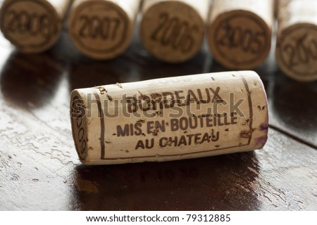 Close up shot of a collection of generic corks from Bordeaux red wine region, focus on one object - stock photo