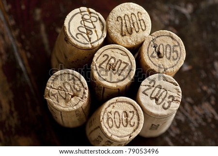 Close up shot of a collection of generic corks from Bordeaux red wine region, focus on the vintage 2003-2009 - stock photo