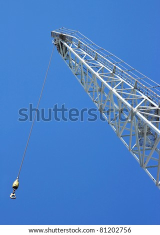 Close up shot of a crane at a harbour - stock photo
