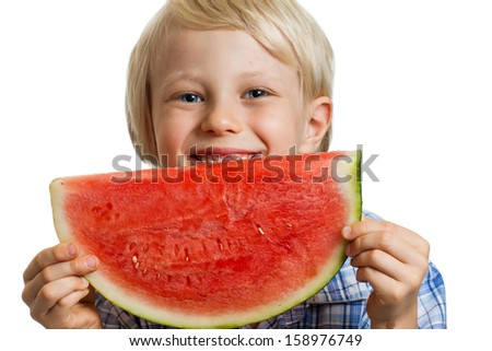 Close-up shot of a cute happy  boy smiling behind a juicy  slice of watermelon. Isolated on white.