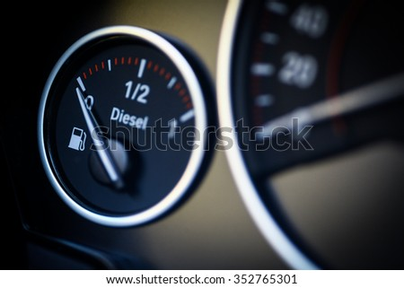 Close-up shot of a fuel gauge in a car.