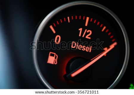 Close-up shot of a fuel gauge in a car. - stock photo