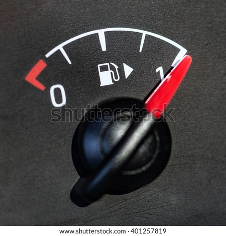 Close-up shot of a fuel gauge in a car. Shallow depth of field.