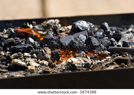 close-up shot of a furnace with hot flaming coal - stock photo