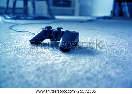 close up shot of a Gamepad on floor - stock photo