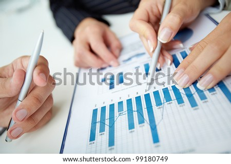 Close-up shot of a graph indicating the progress in the work of the team - stock photo