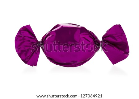 Close-up shot of a hard candy wrapped in shiny candy wrapper over white background. - stock photo