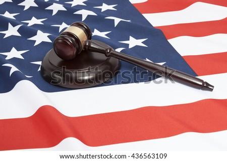 Close up shot of a judge gavel over USA flag - stock photo