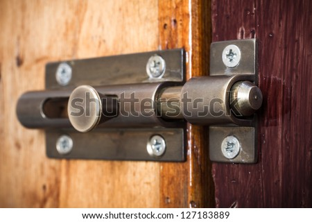 Close-up shot of a latch on a wooden door - stock photo