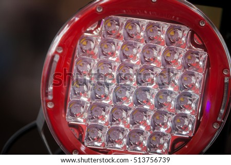 Close up shot of a LED round projector on a car.