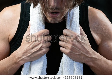 Close-up shot of a man after his workout, front view. - stock photo