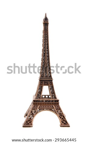 Close up shot of a miniature model of the Eiffel Tower on a white background