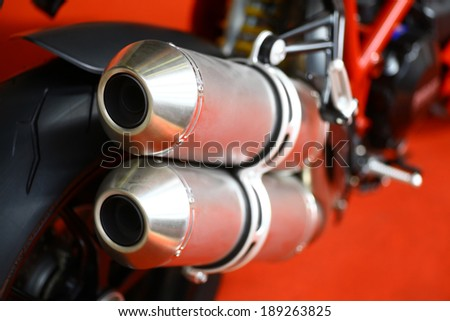 Close up shot of a motorcycle exhaust pipes.