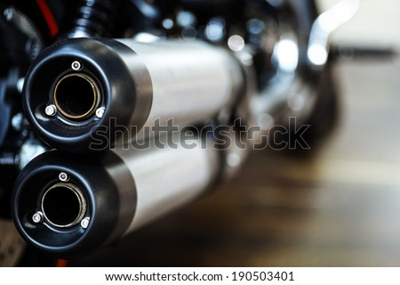 Close up shot of a motorcycle exhaust pipes. - stock photo
