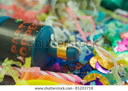 Close up shot of a Party Popper and party confetti - stock photo