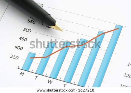 Close-up shot of a pen on chart. - stock photo