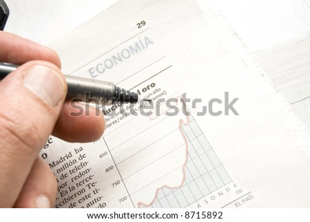 Close up shot of a pen on stock price chart. - stock photo