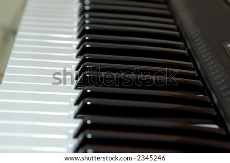 Close up shot of a piano shot with artifical light