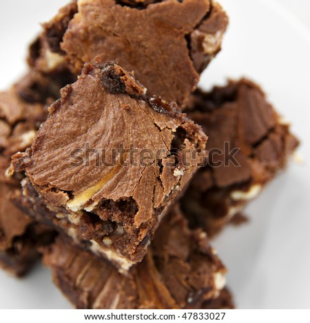 close up shot of a pile of chunky cheesecake brownies - stock photo