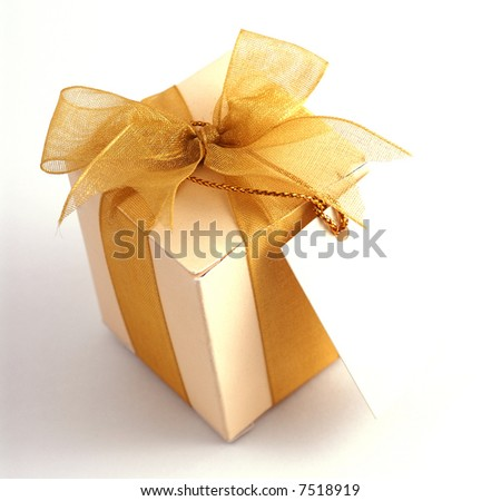 Close-up shot of a small box of appreciation gift with a blank note. Selective focus is intentional. - stock photo