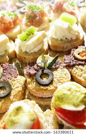 Close up shot of a small catering sandwiches. Finger food and party concept - stock photo