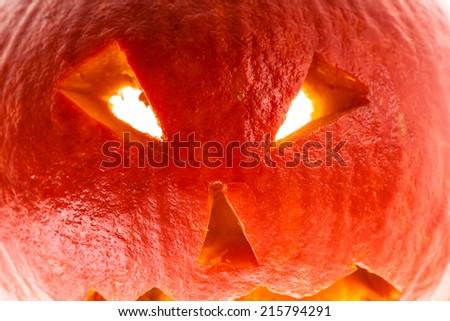 close up shot of a small Jack-o'-lantern halloween decoration face - stock photo