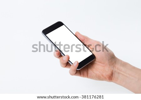 Close up shot of a smartphone and a male hand isolated on white background