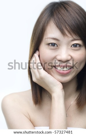 close up shot of a smiling asian girl - stock photo