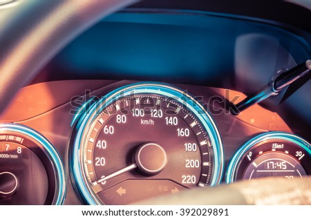 Close up shot of a speedometer in a car. Speedometer in parked car with LCD display of odometer and trip calculator. - stock photo