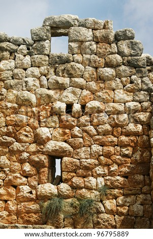 close up shot of a stone wall and window - stock photo