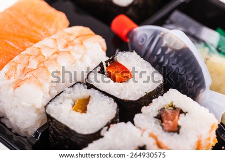 close up shot of a sushi box or bento box with assorted sushi pieces - stock photo