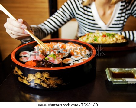 Close-up shot of a sushi plate (shallow DoF, focus on sushi) - stock photo