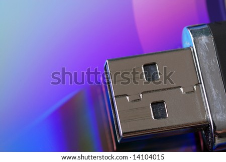 Close up shot of a USB drive on a colorful background