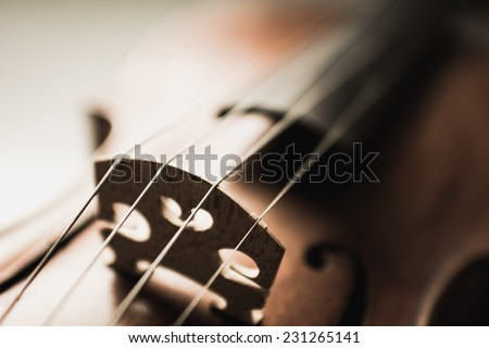 Close up shot of a violin,very soft def of field - stock photo