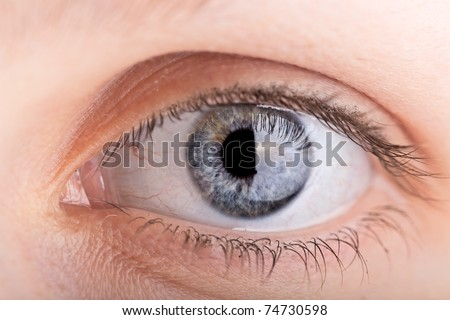 close up shot of a womans eye with shallow DOF - stock photo