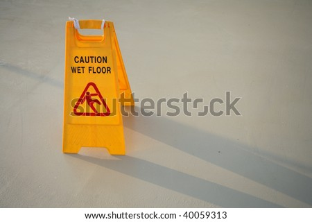close up shot of a yellow caution on floor