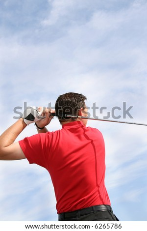 Close up shot of a young golfer from behind - stock photo