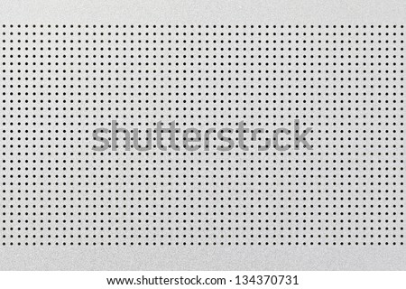 close up shot of aluminium holed or perforated grid texture background. dot pattern - stock photo